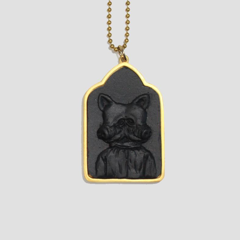 Lucky Pig | Neckpiece   Colour : Black / Gold  size : W4 x D0.5 x H6 cm  price : 1,200 THB