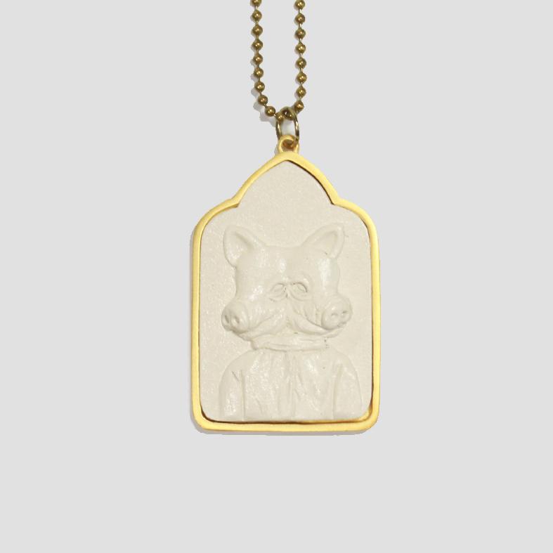 Lucky Pig | Neckpiece   Colour : White / Gold  size : W4 x D0.5 x H6 cm  price : 1,200 THB