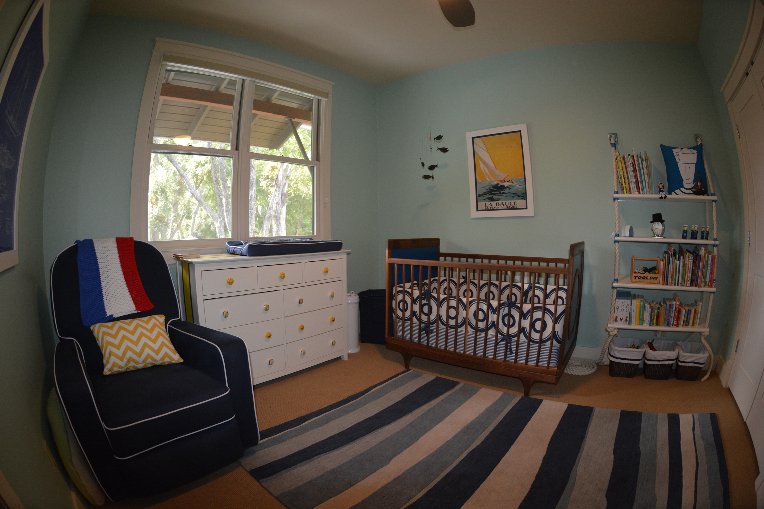 A fish-eye view of the complete room.  Our wall color is PPG's Malted Mint. Stay tuned for more posts on our beautiful crib and dresser.
