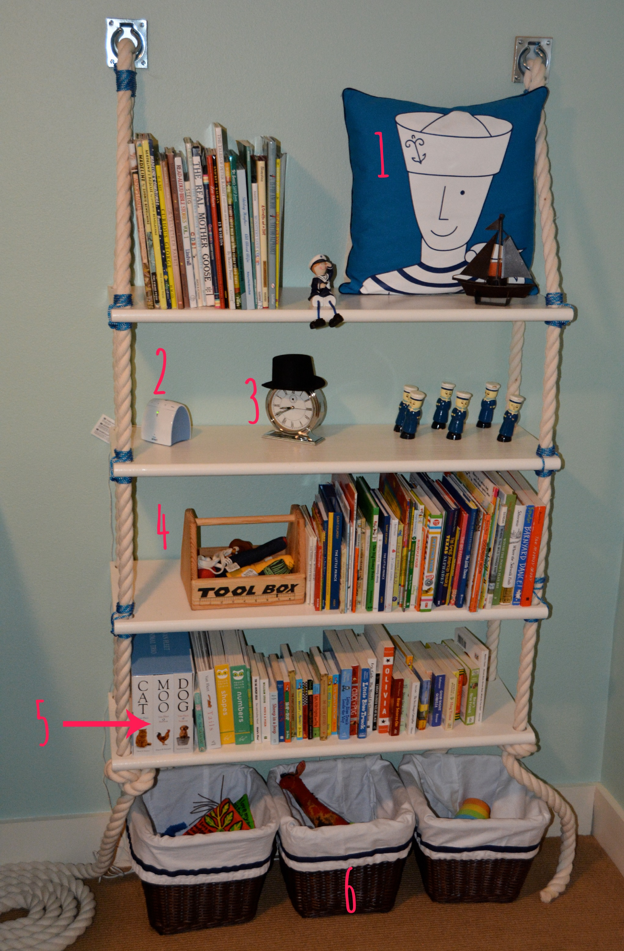 The rope on the bookcase adds a fun twist without being too kitschy.
