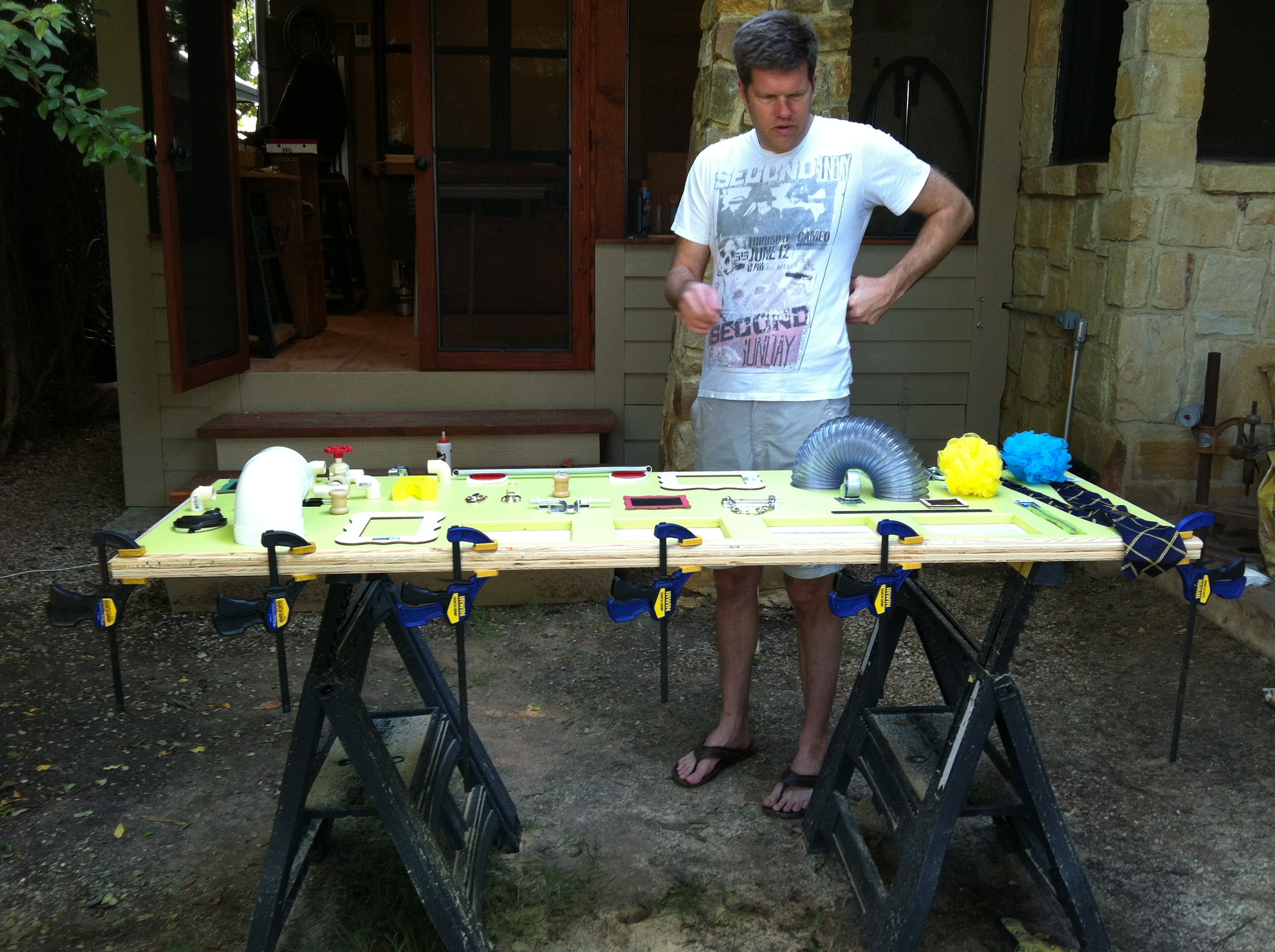 Jon contemplates our layout while the wood glue for the frame dries.