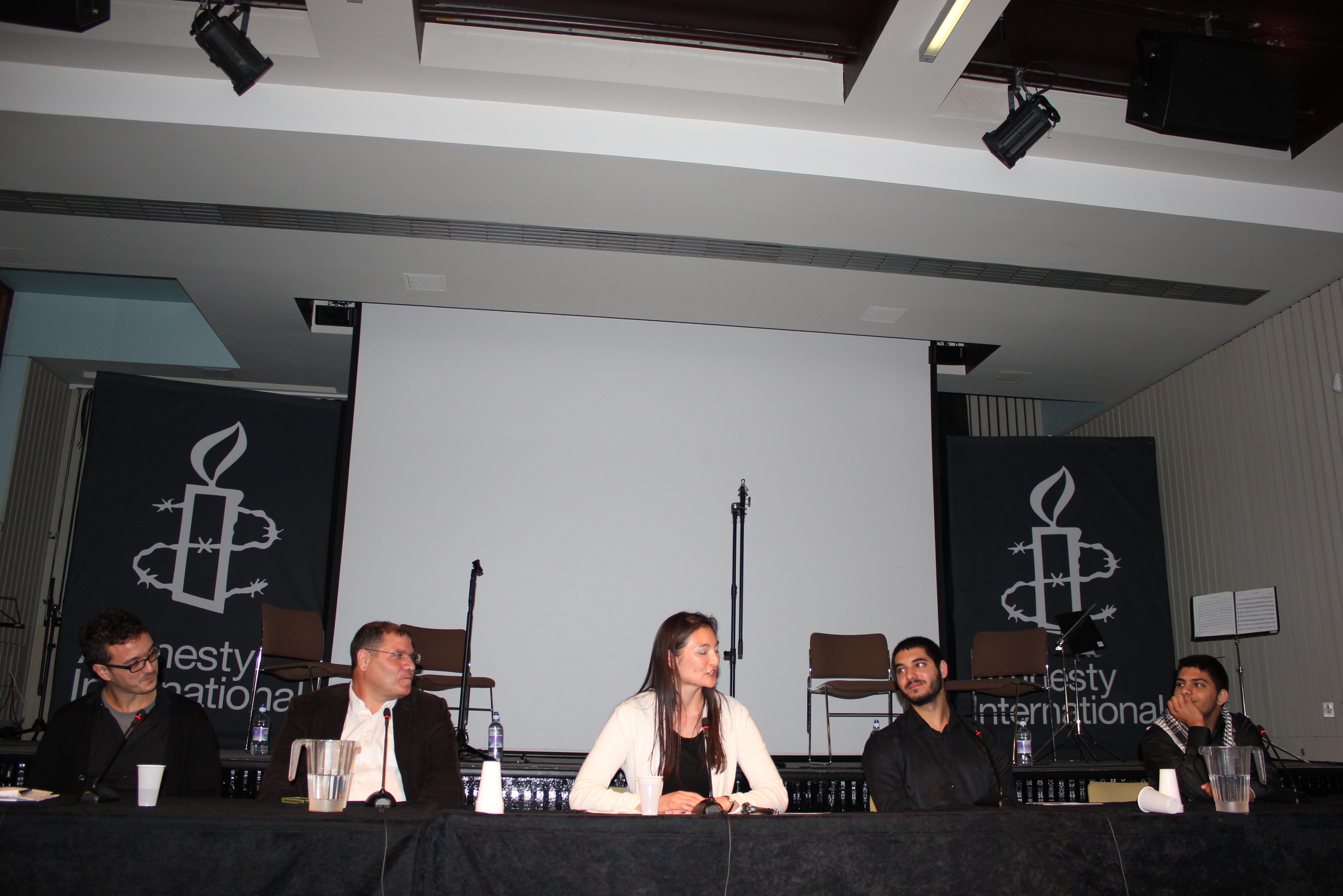 Chairinga panel for Amnesty International, October 2014
