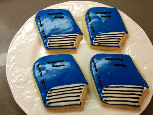 Blue Baker cookies in the shape of books! All proceeds go to Books and a Blanket.