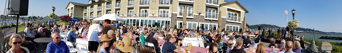Guests enjoy the barbecue and the Lowdown Brass Band outside the Hotel Bellwether on Tuesday, July 31, 2018, in Bellingham, Washington. (Photo by Ray Deck III)