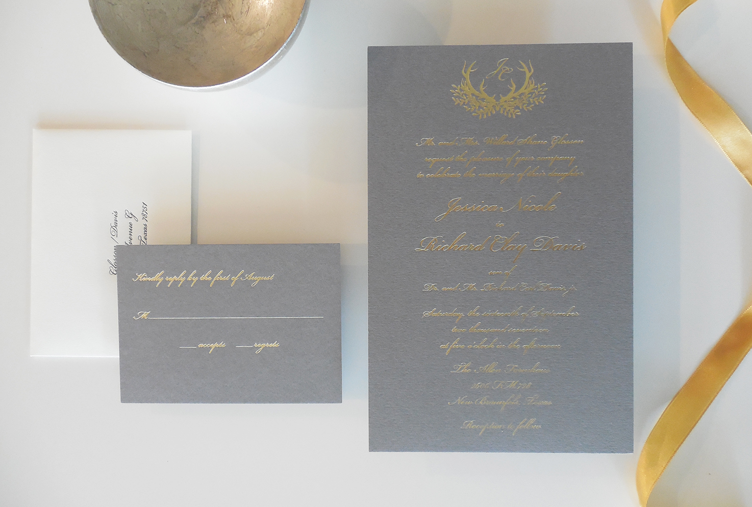 Classic gold foil on heavy charcoal stock.