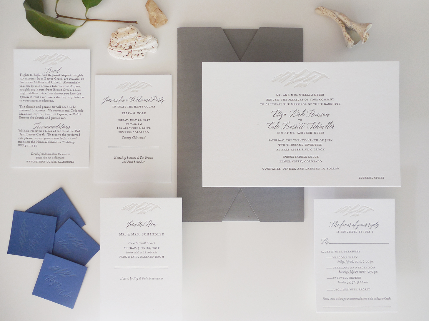 An earthy, elegant paper suite for a wedding in Colorado with a custom mountain sketch, printed in a translucent gray.  A folder is ideal for destinations where many are traveling.