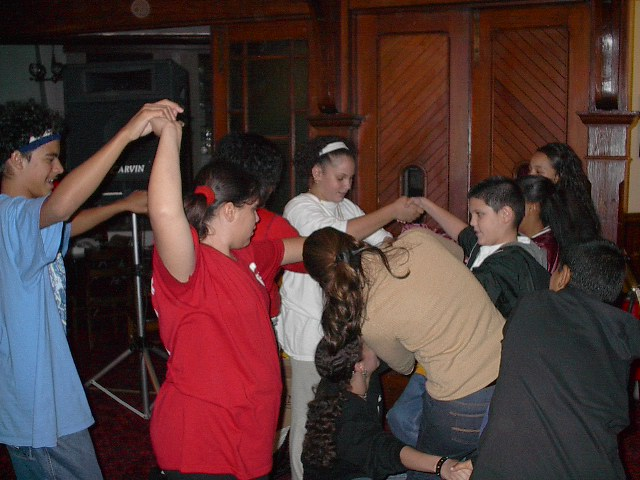 Students participate in the Human Knot game, early in the Bridge's history in the 2nd Presbyterian Church.