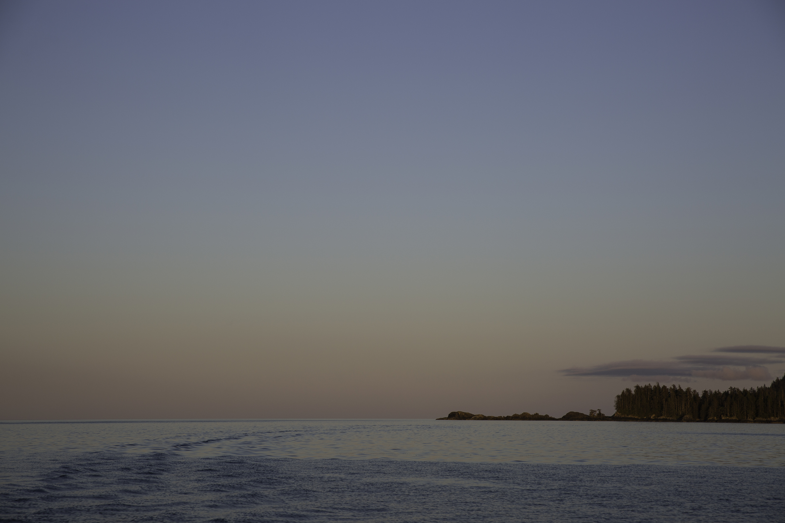 The stern wake fades off into the distance as the sunset turns the lights down and we round into Haida Gwaii.