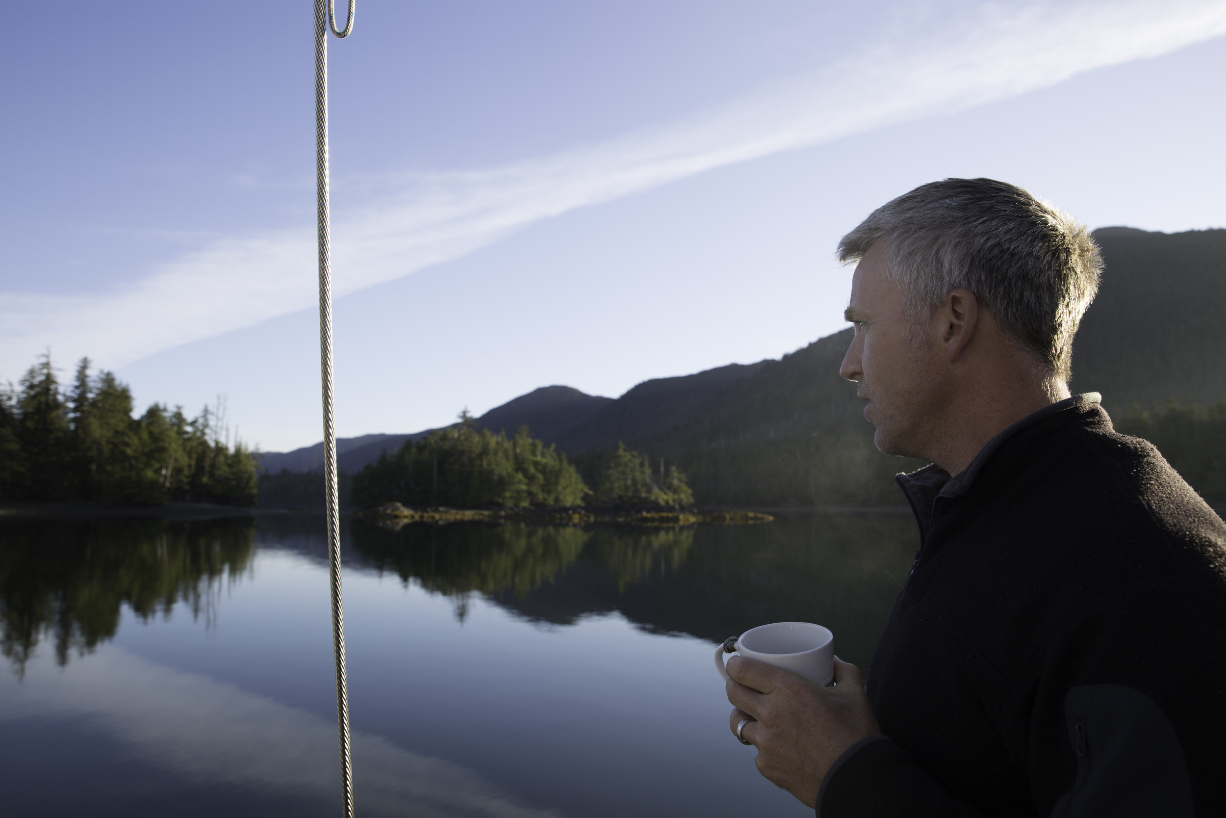 James sips a cup of coffee and complains about the view.