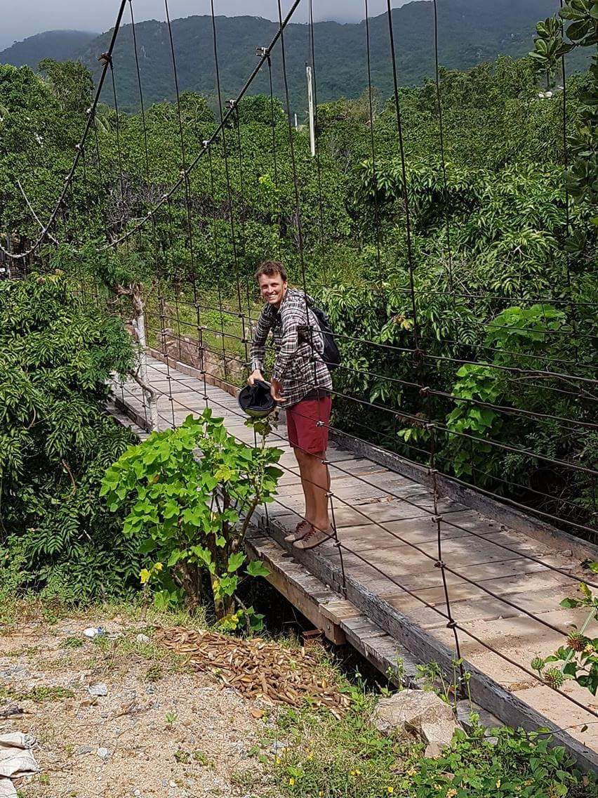 Old wire and wood suspension bridge