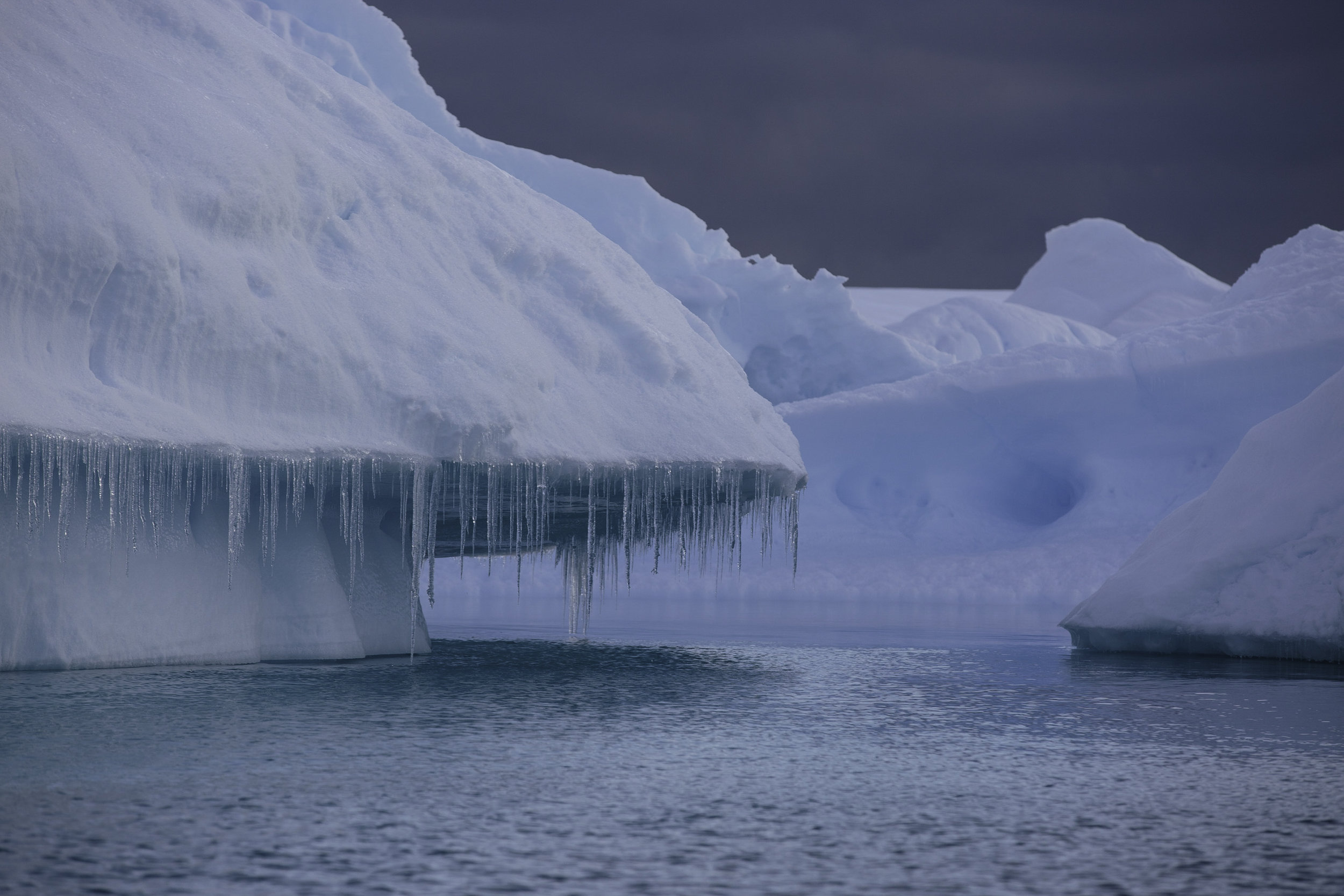 Icicles form after a day of intense sunshine in an iceberg graveyard just north of the Lemaire Channel.