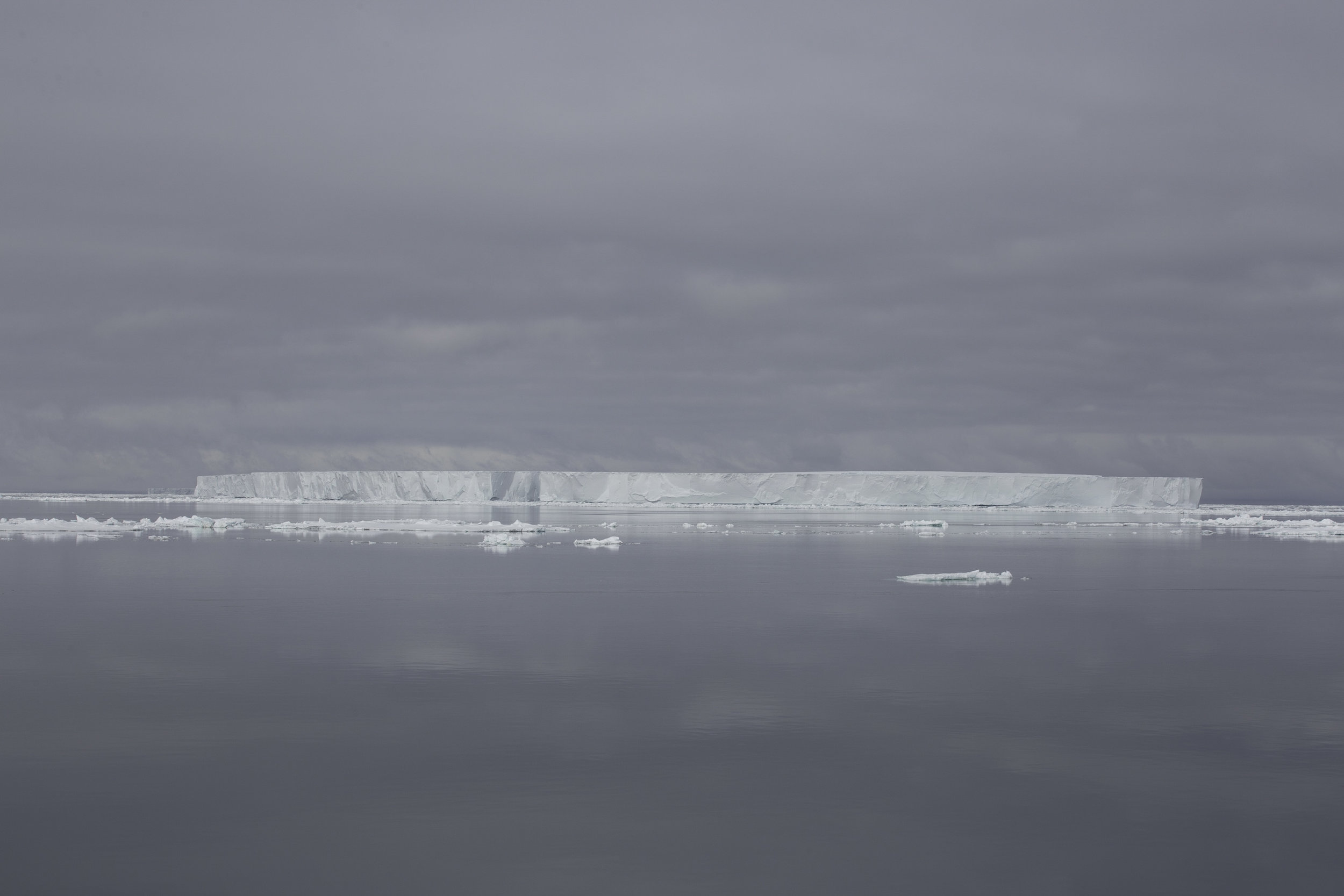 The Weddel Sea on a surreal calm day with tabular ice bergs 100+ meters high and kilometres floating all around.