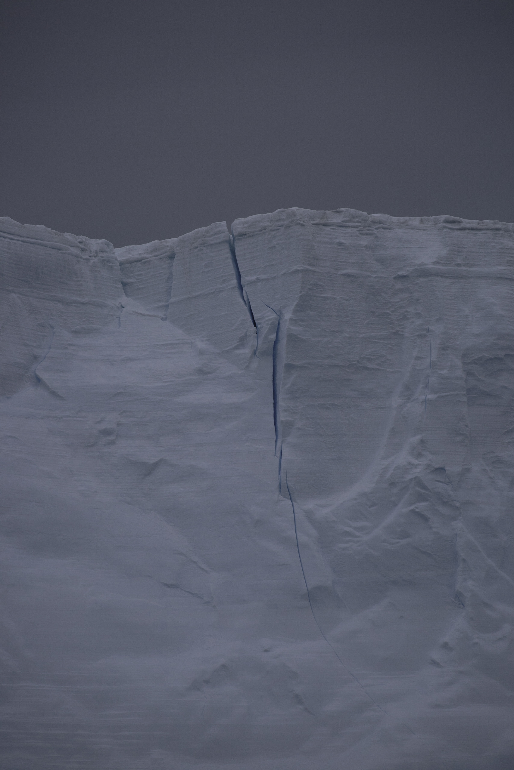 This crack is probably close to 30m long running down the side of a tabular iceberg.