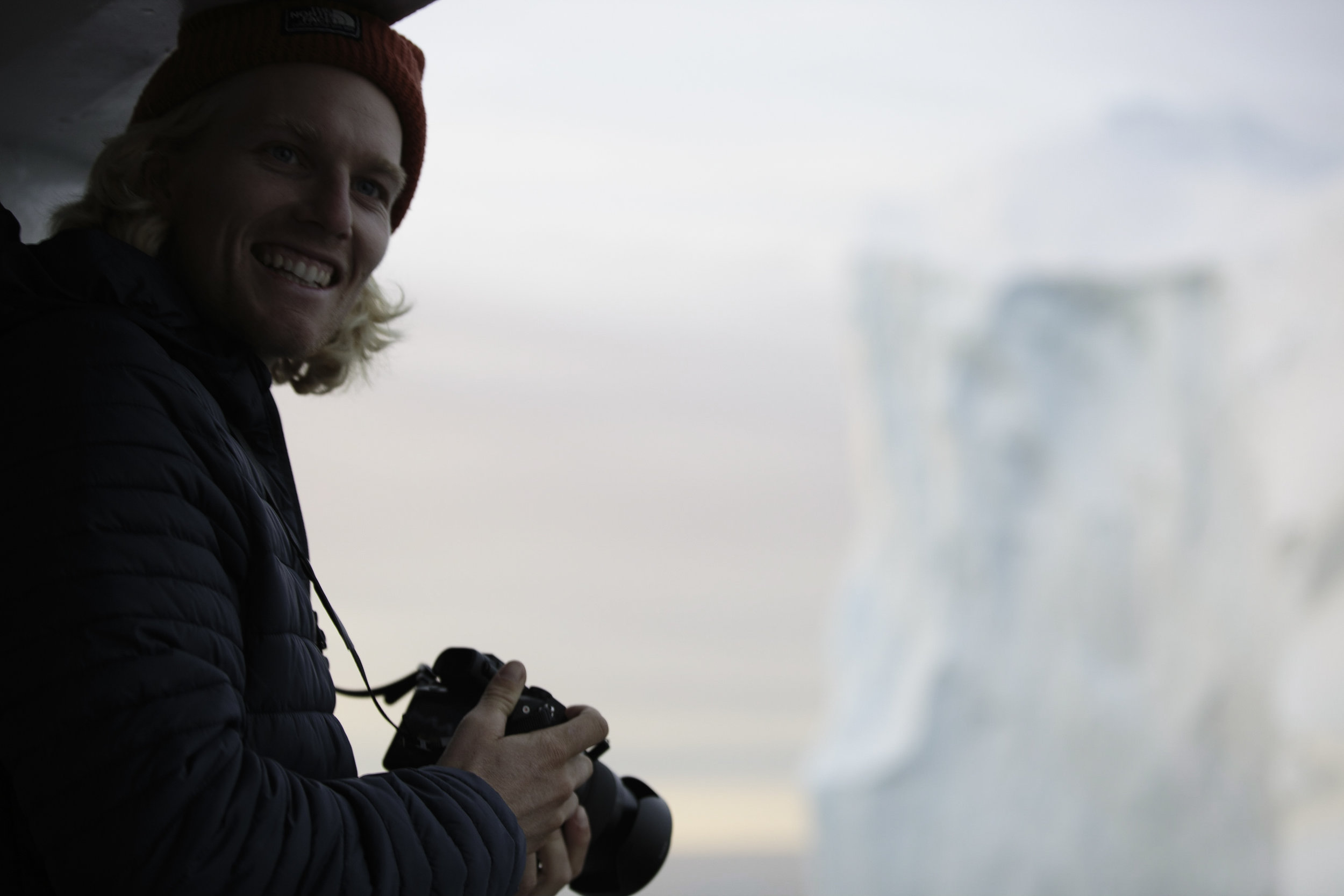 Blake grabbing a snap of an iceberg passing by.