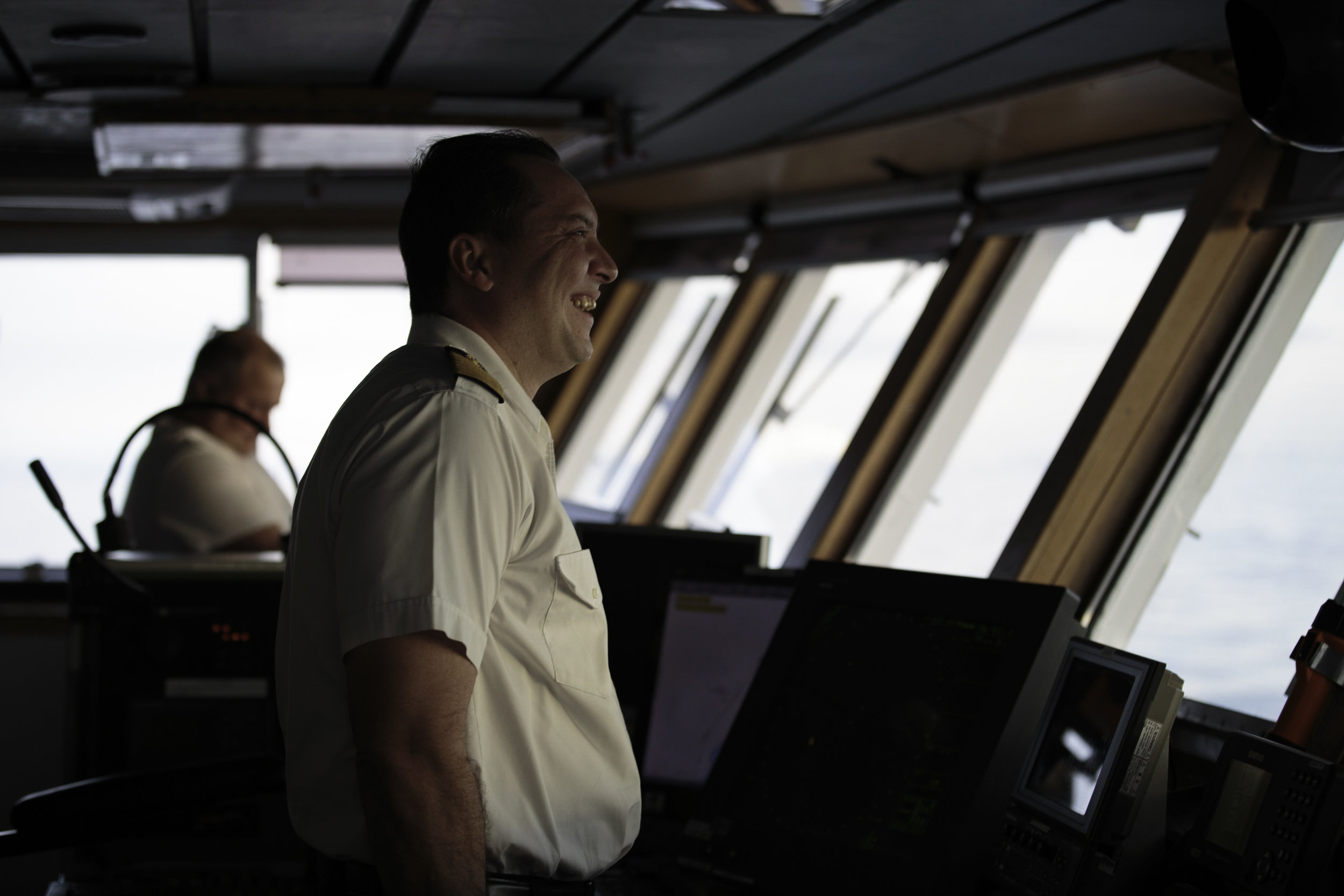 Captain Barios, from Panama, cracks a joke with the Chief Engineer from Ukraine.