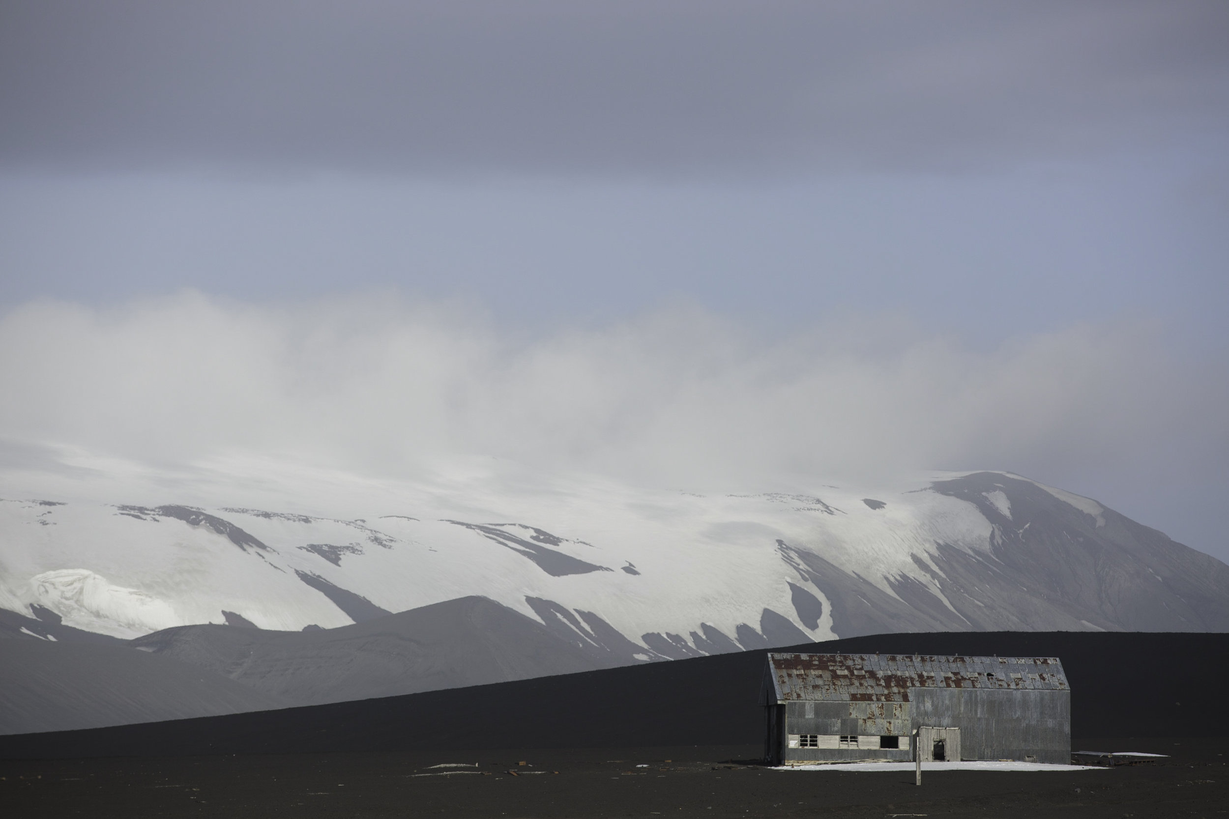 An old airplane hanger built by the British lies abandoned on Deception Island.
