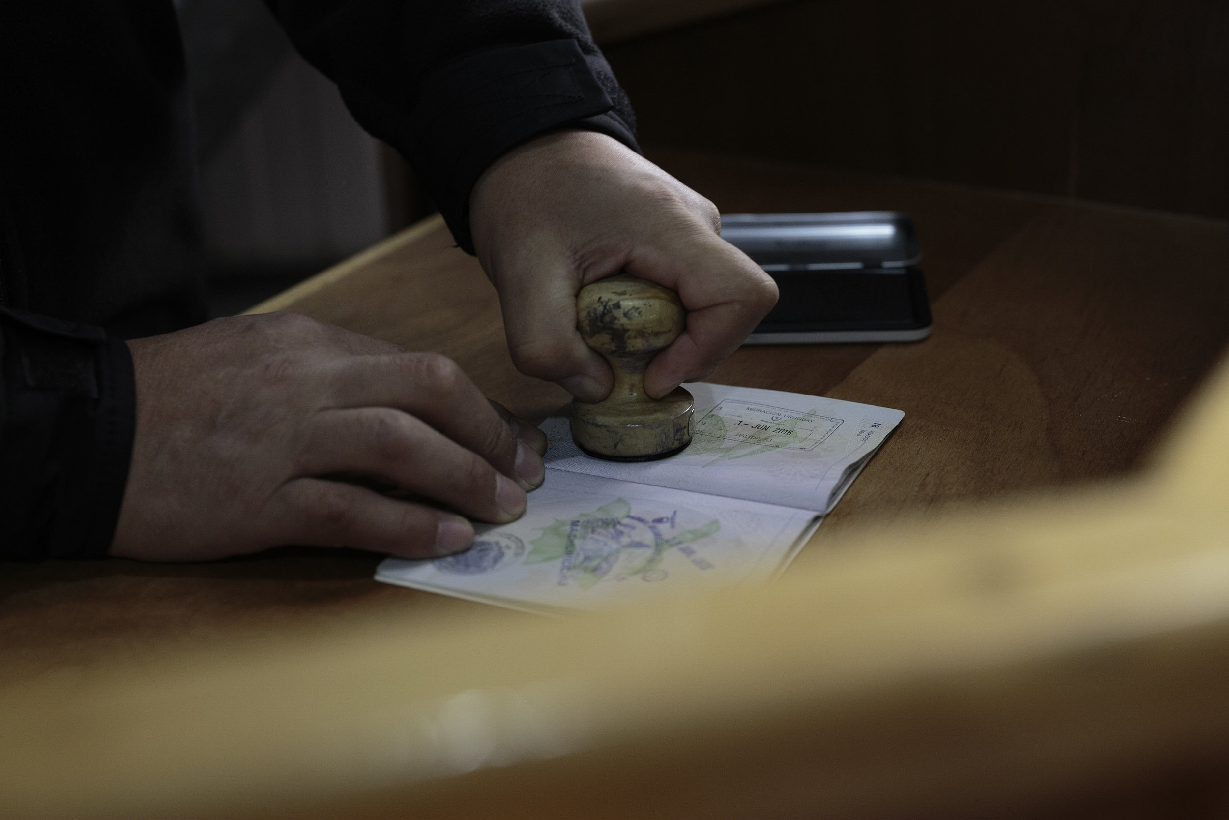 A Chilean military officer stamps passports at O'Higgin's base.