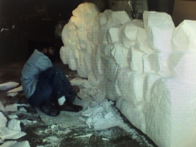 Carving fake stone wall from foam before it goes to scenics for paint and dressing