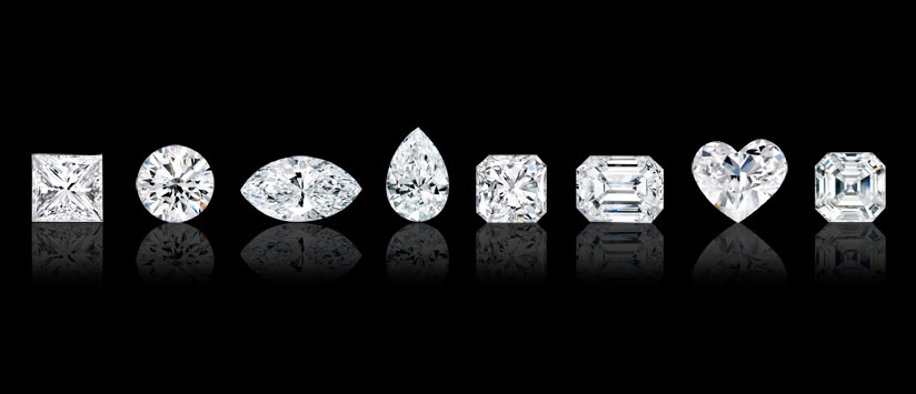 White diamonds in various cuts and shapes. From the left to right, princess square, round brilliant, marquise, pear, radiant, emerald, heart and asscher.