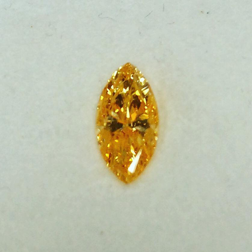 Fancy intense yellow orange diamond in marquise. Untreated. A massive 1.07 carat     Yves Frey Diamonds