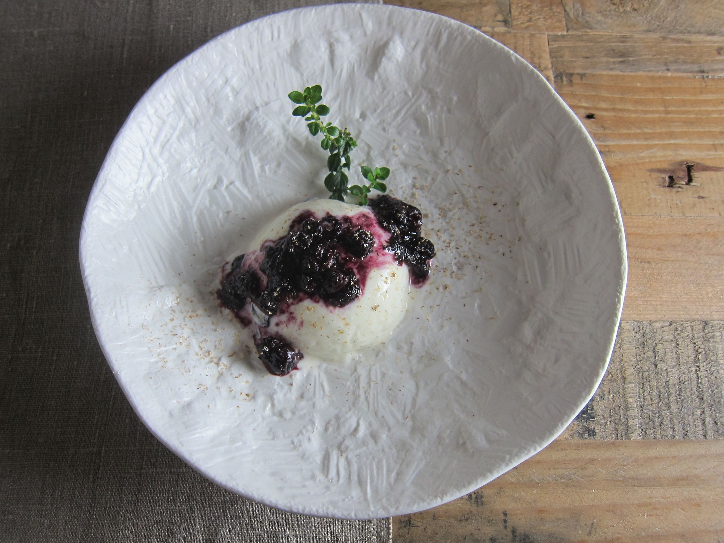 Panna cotta variation: Blueberry compote and grated nutmeg.