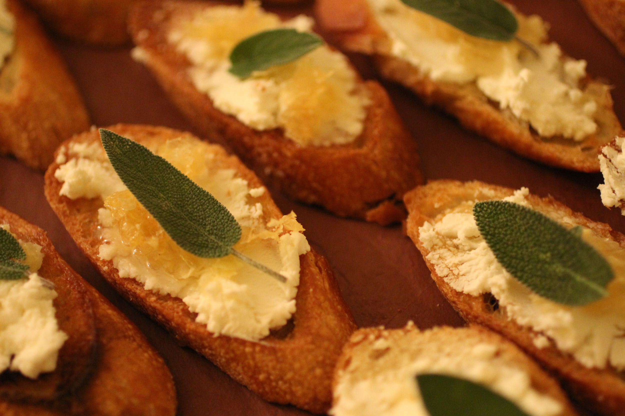 Creamy, tart chèvre backdrop with sweet, crunchy honeycomb, and rustic sage.