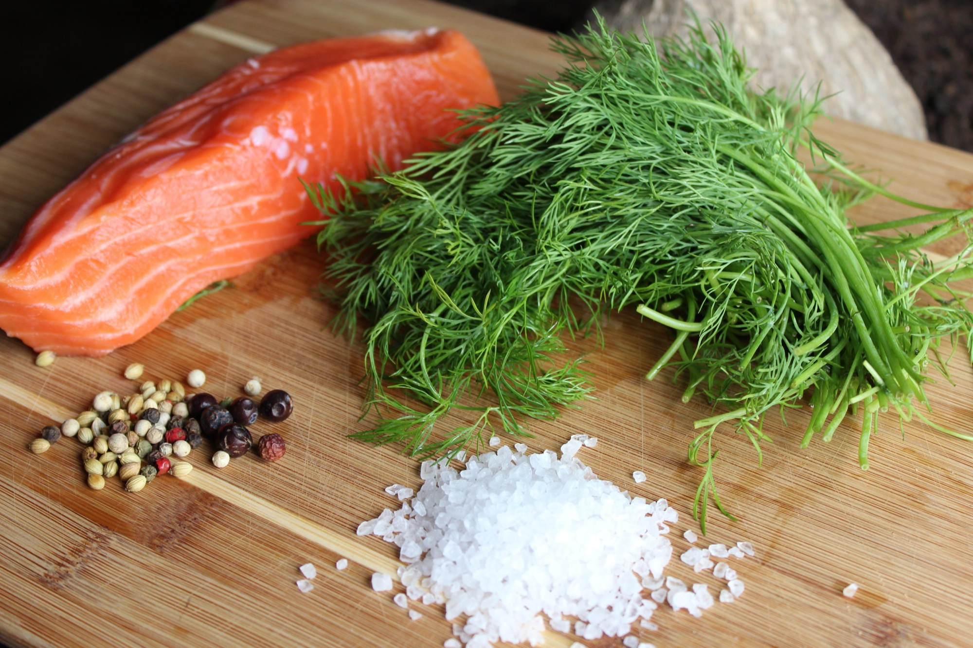 Classic flavorings for gravlax. This recipe uses pink peppercorn, but you can also use white, black or a mix, as you see here with or without other spices such as juniper, fennel, and caraway.
