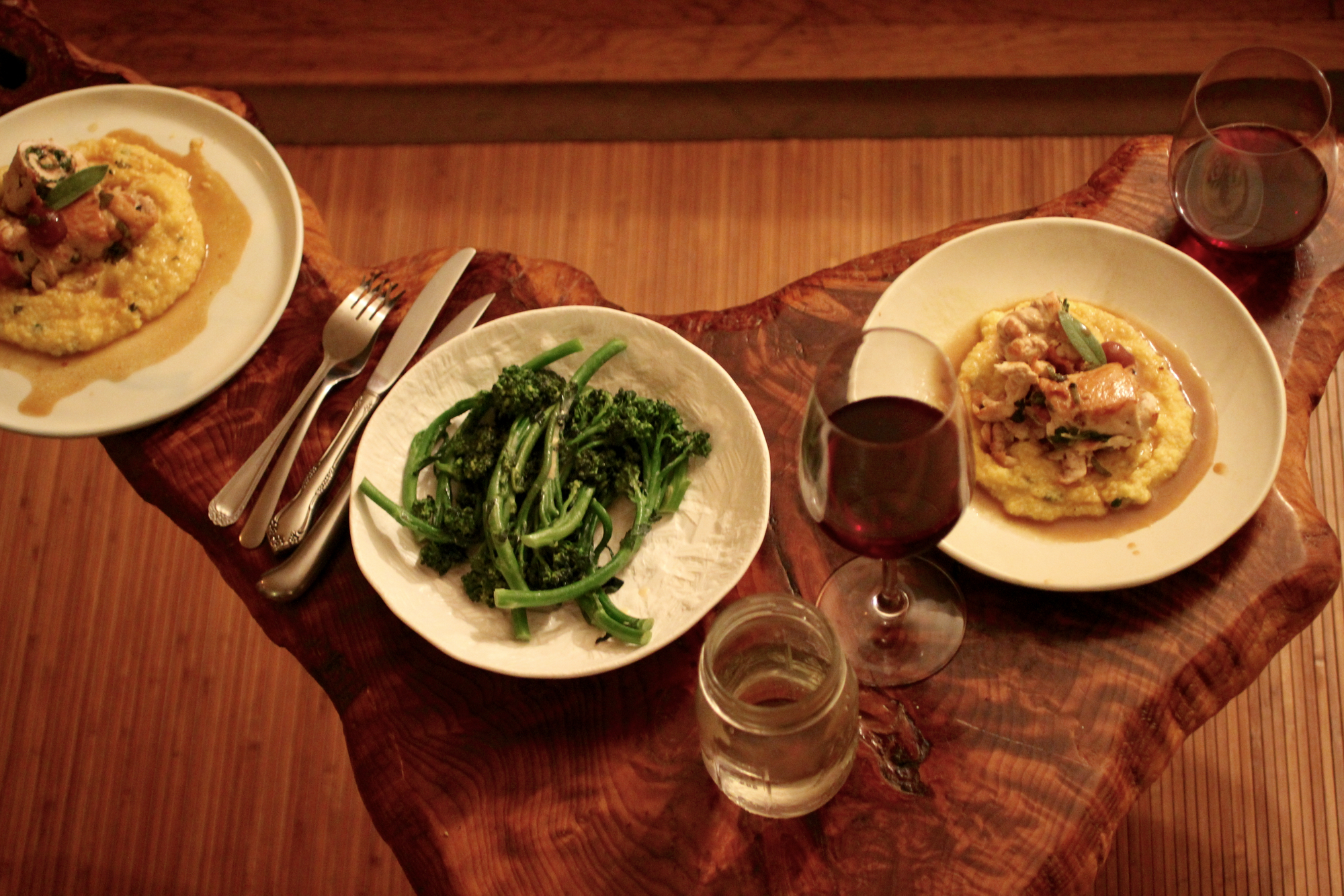 A meal of chicken brandied cherry saltimbocca, broccolini, and of course, wine.