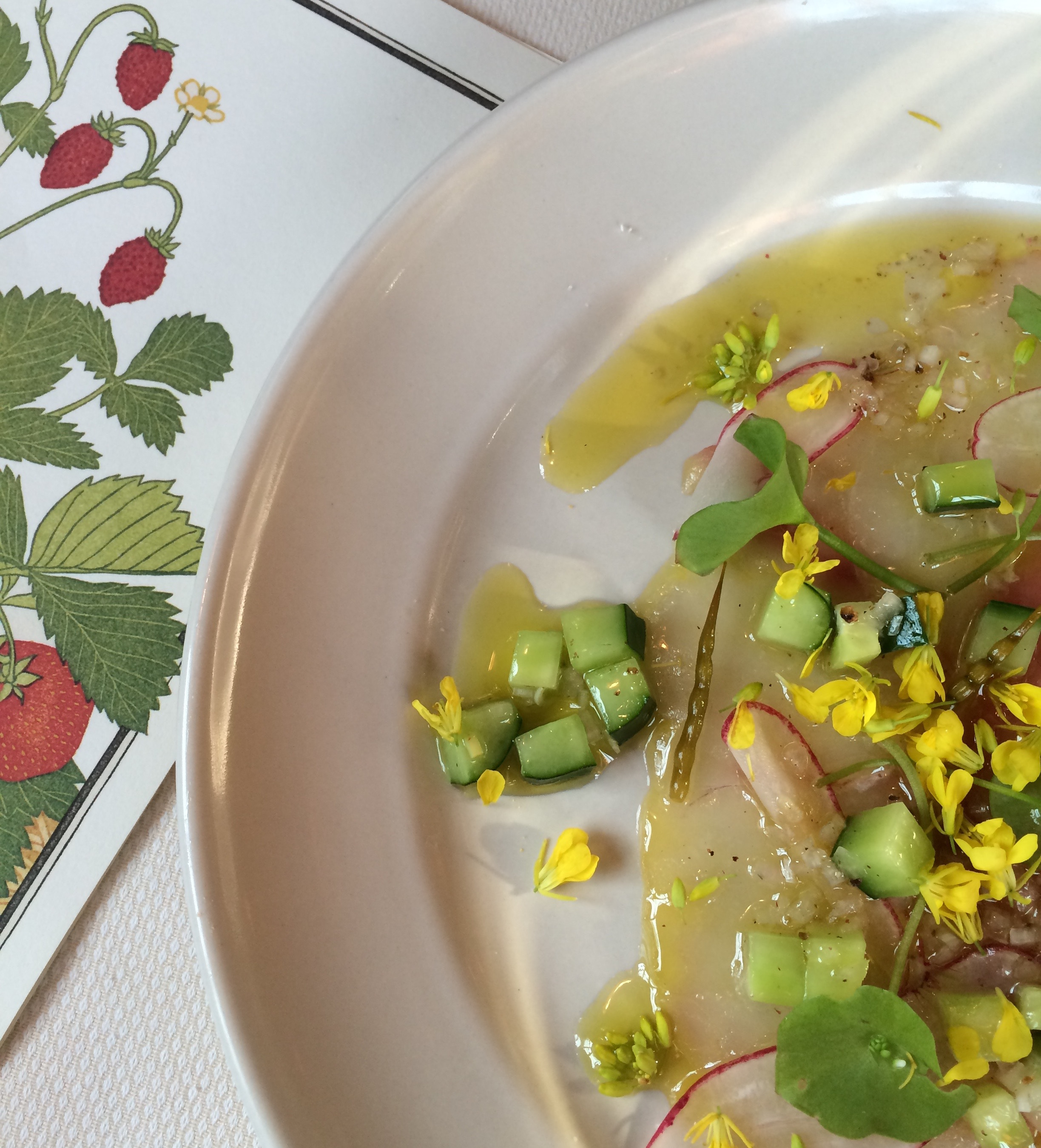 A delicious crudo dish with nasturtium and mustard flower from  Chez Panisse  for Wild and Feral Food Week 2016. Chez Panisse has participated in WFFW every year since its inception.