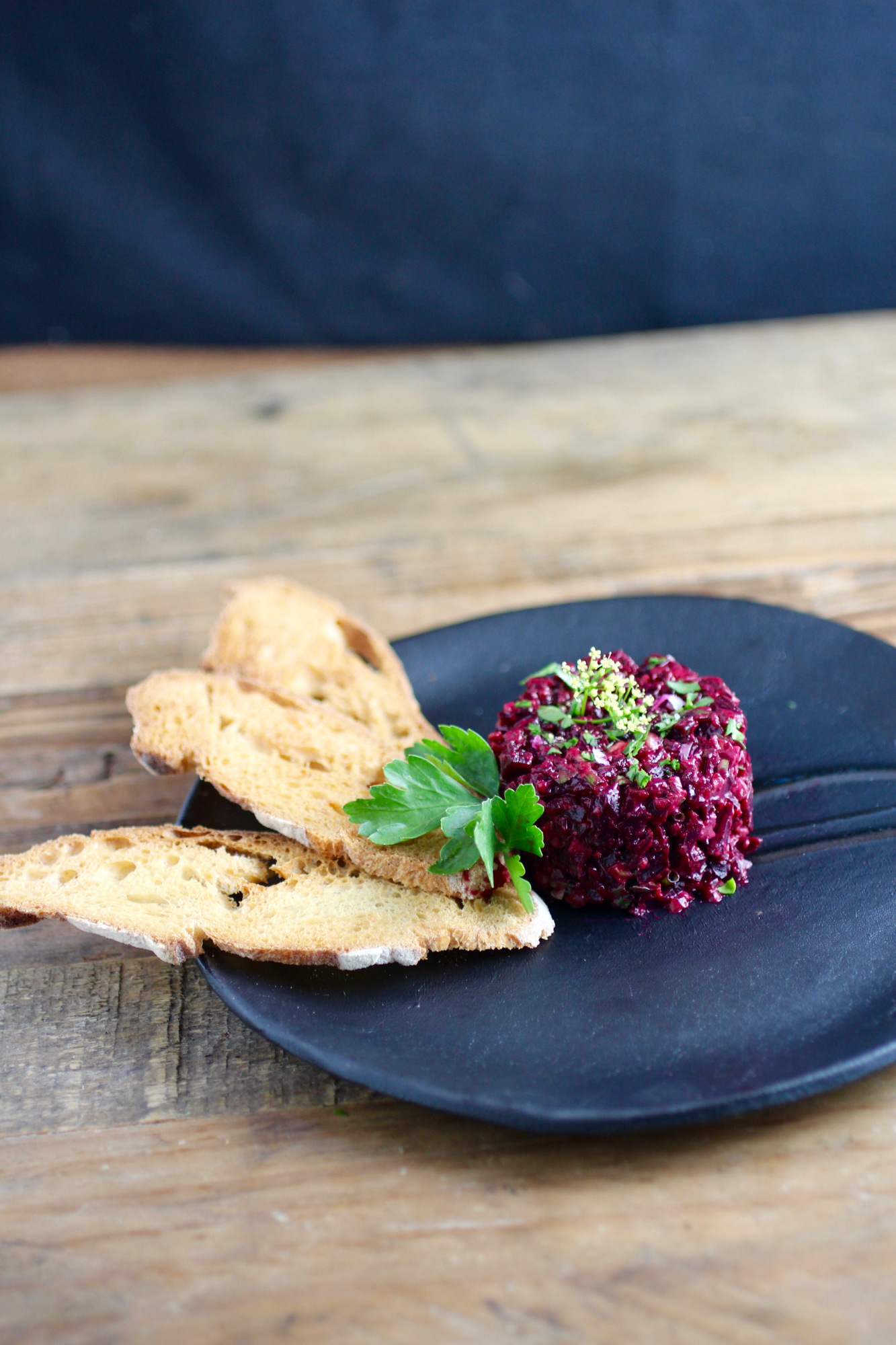 Beet tartare served with baguette crisps, but you can use any edible vehicle for the tartare of your choosing.