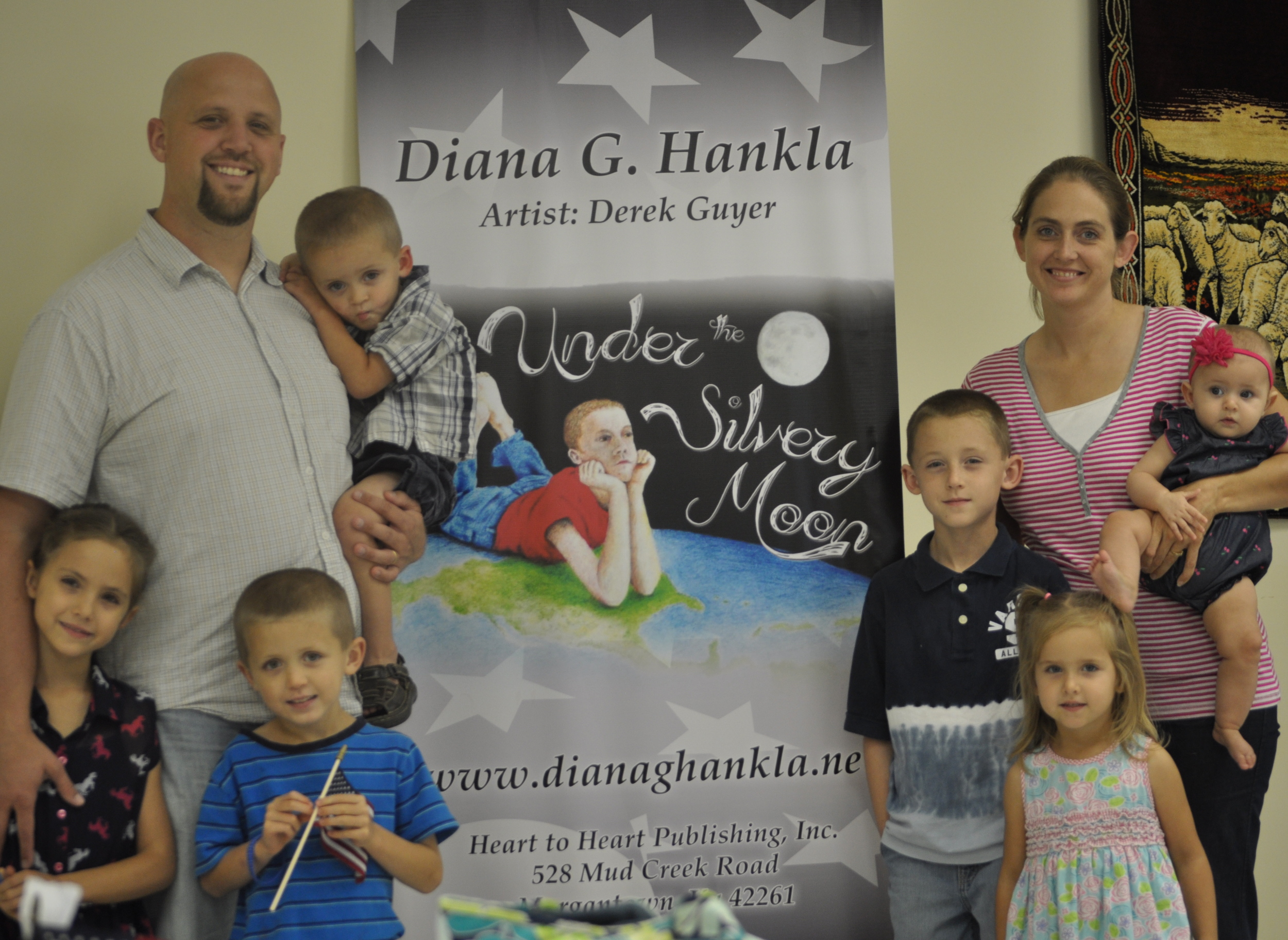 Derek and Lisa Guyer and their children at the first book signing for the release of Under the Silvery Moon.
