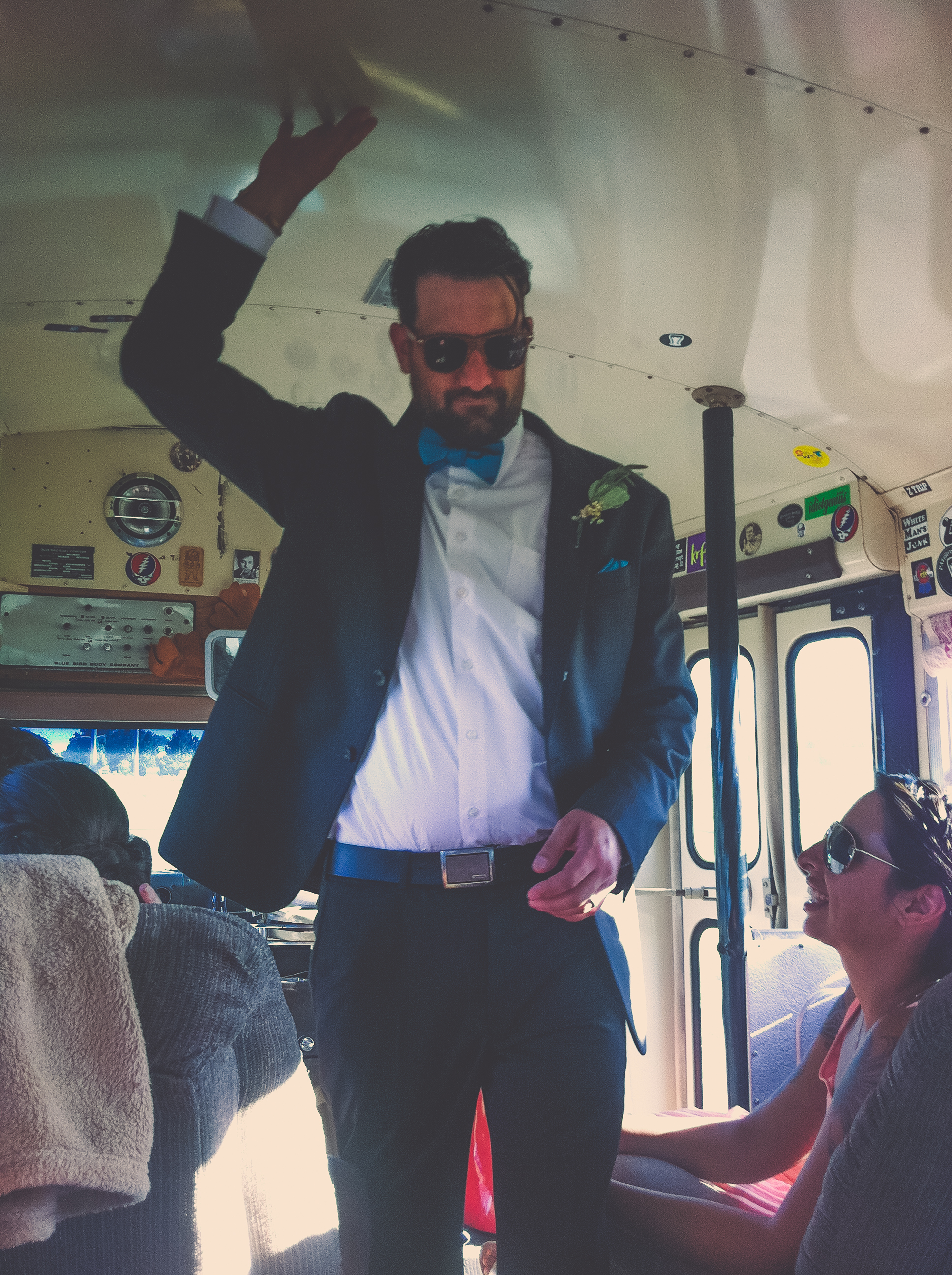 Max on the party bus from the ceremony site to the reception. A married man.