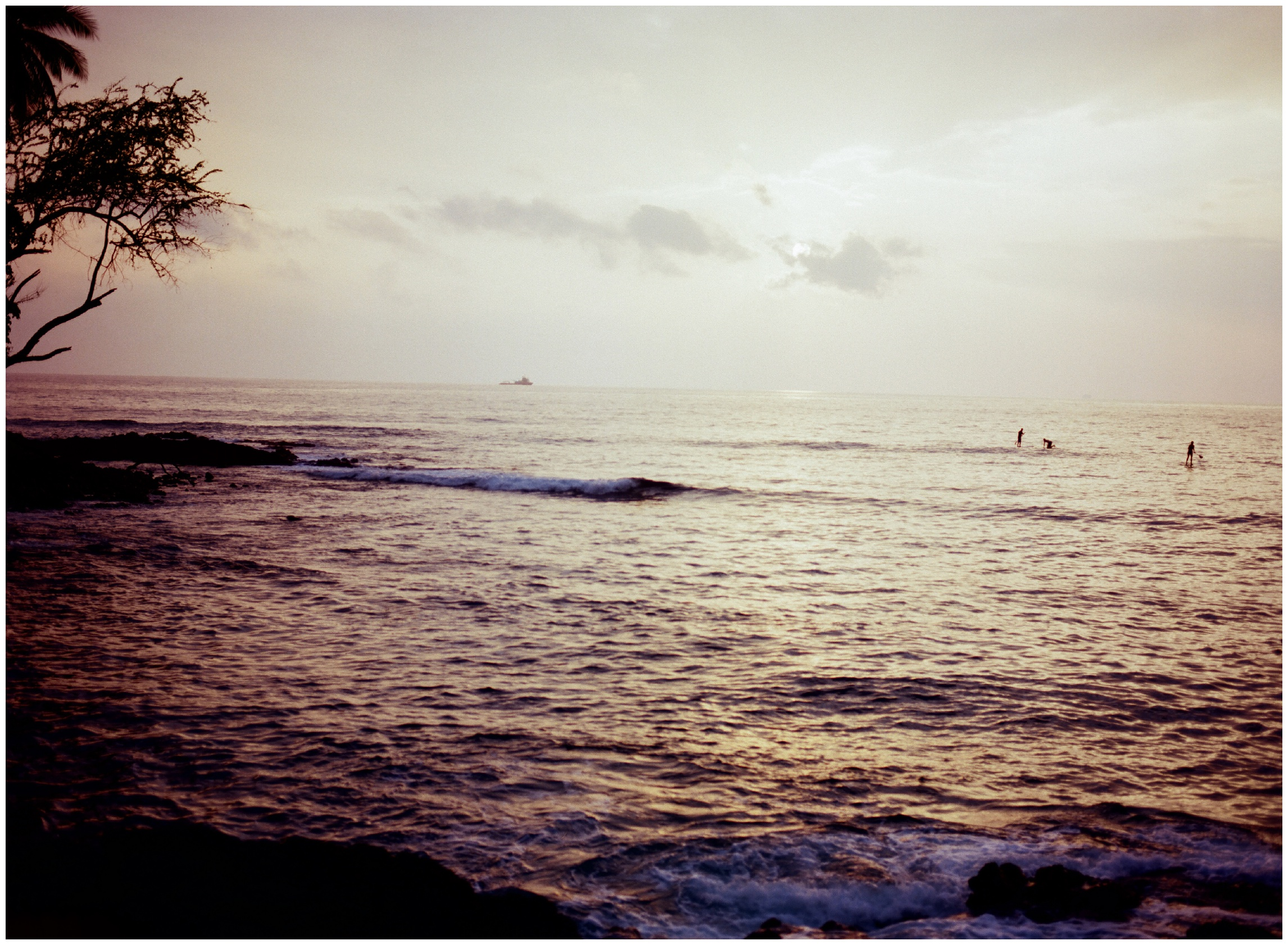 The surf at sunset at Kamoa Point, Hawaii. Film photography by Sonja Salzburg of Sonja K Photography.