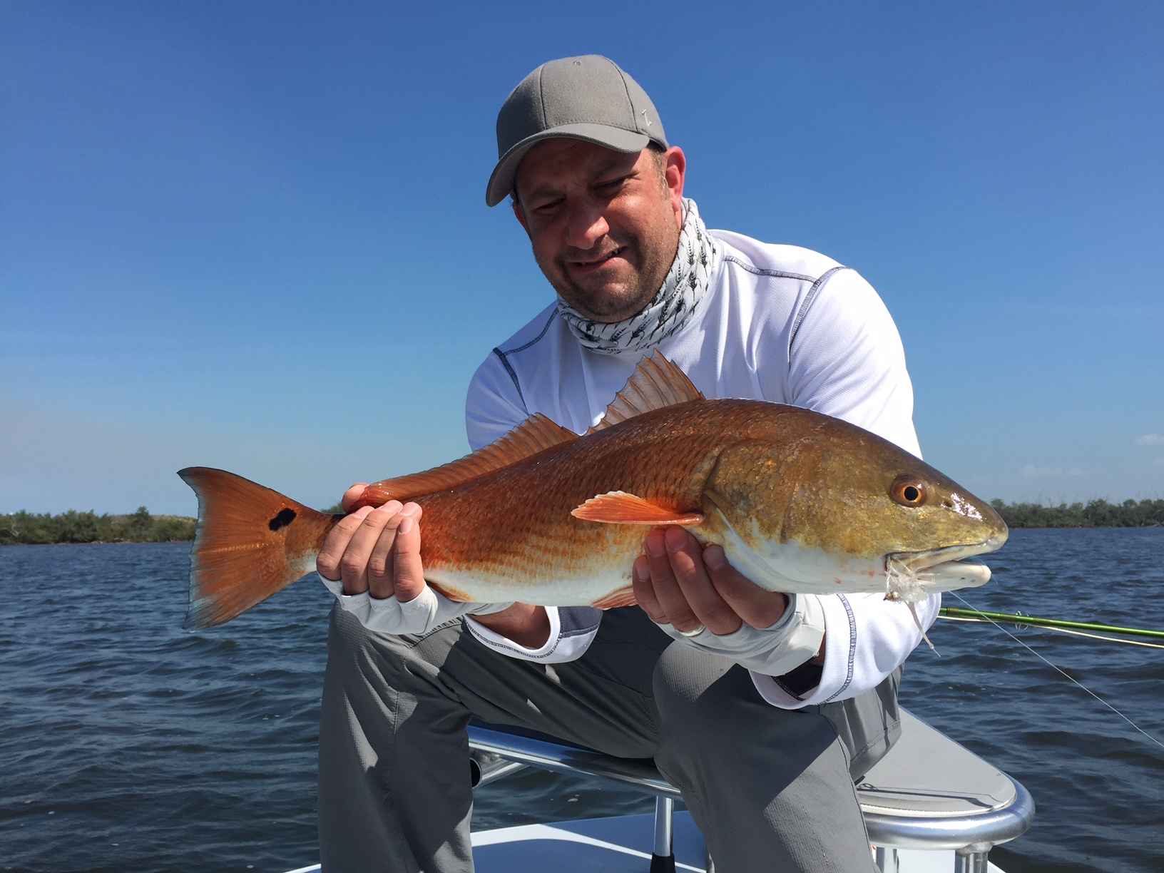 Max Salzburg with a redfish in Mosquito Lagoon. Photo by Bruce Salzburg.
