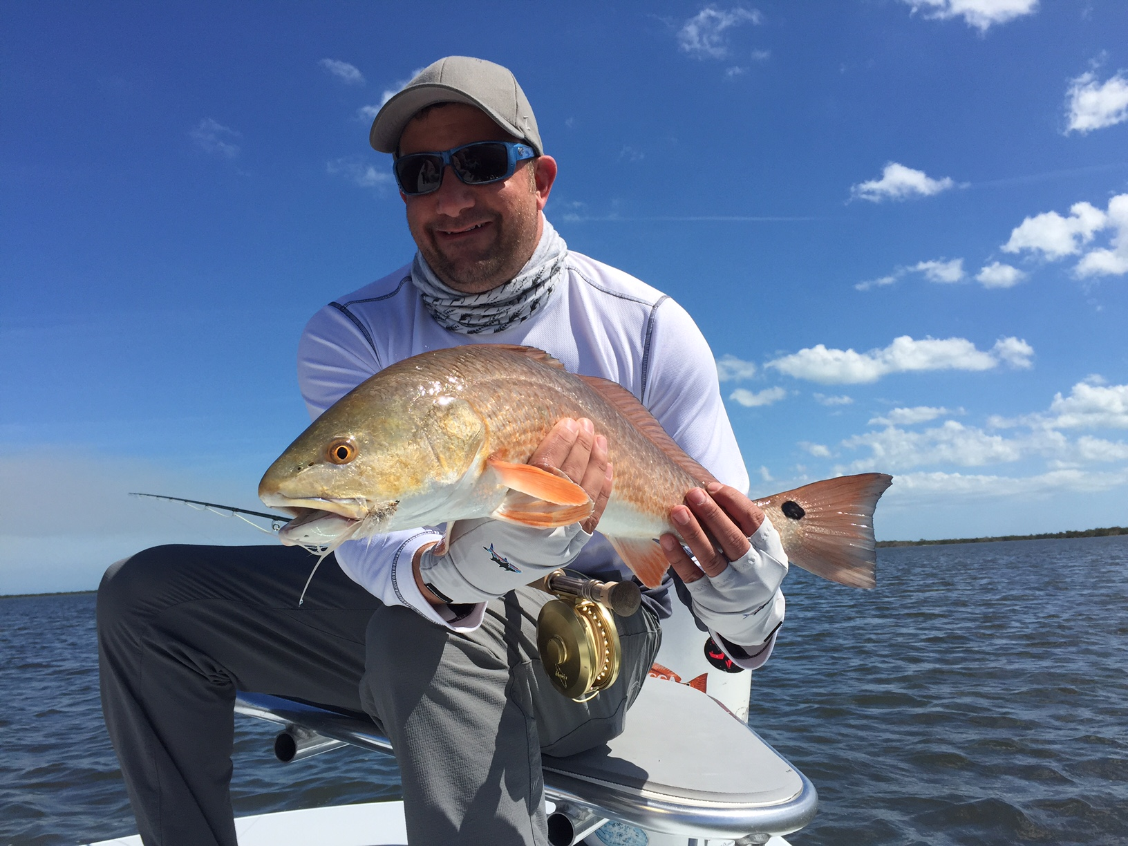 Max Salzburg with a redfish in Mosquito Lagoon near Titusville, Florida. Photo by Captain Scott MacCalla.