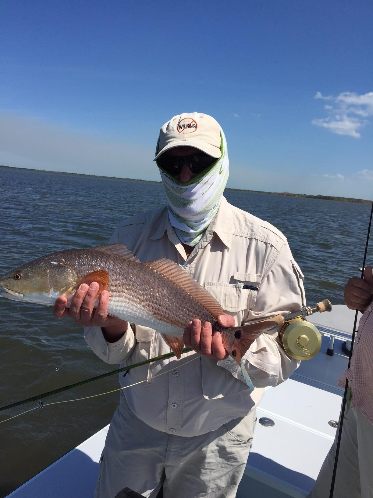 My dad, Bruce Salzburg, and the first redfish of the day. Photo by Max Salzburg of Sonja K Photography.