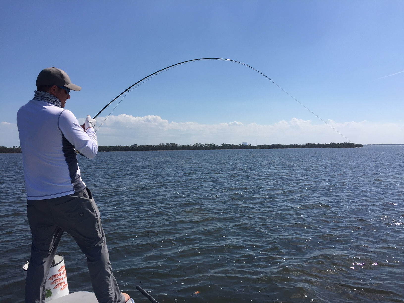 Fish on! Max Salzburg with a redfish on the line in Mosquito Lagoon near Titusville, Florida.