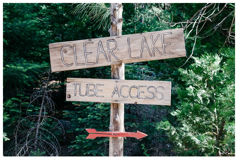The sign for Clear Lake tube access. Travel photography by Max Salzburg of Sonja K Photography.