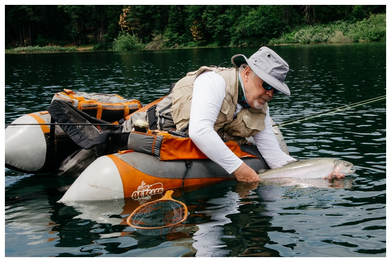 Peder Kruger releases a large rainbow trout at Henderson Springs Ranch near Big Bend and Redding, California. Travel and angling photography by Max Salzburg of Sonja K Photography.