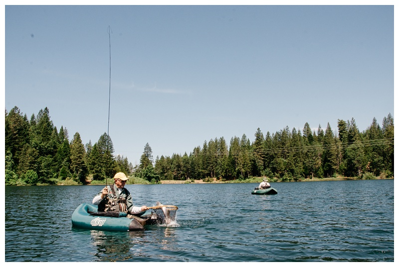 Bruce Pederson with a fish in the net at Big Lake at Henderson Springs Ranch near Big Bend and Redding, California. Travel and angling photography by Max Salzburg of Sonja K Photography.