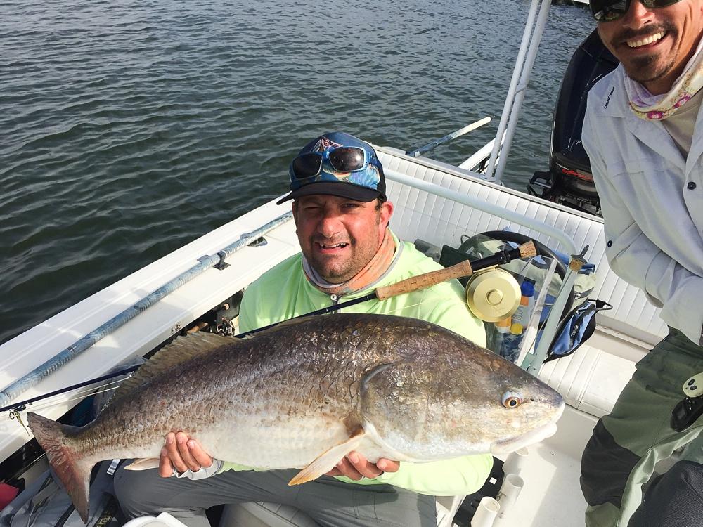 A large bull redfish caught on fly in the Louisiana marsh near Port Sulphur, Louisiana.