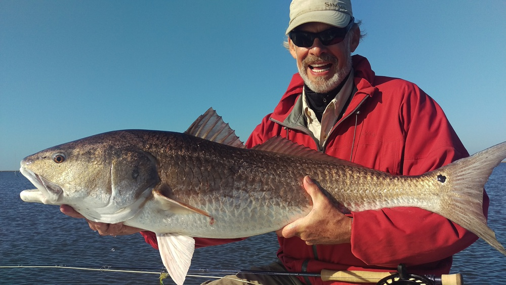 Steve Caldwell with a large redfish caught on fly in the Louisiana marshes near Port Sulphur.
