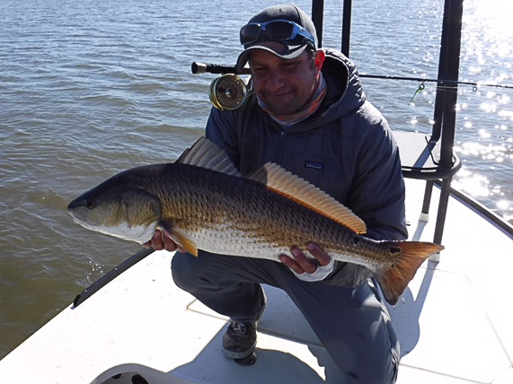 Max Salzburg with a nice redfish in the Louisiana marsh near Port Sulphur.