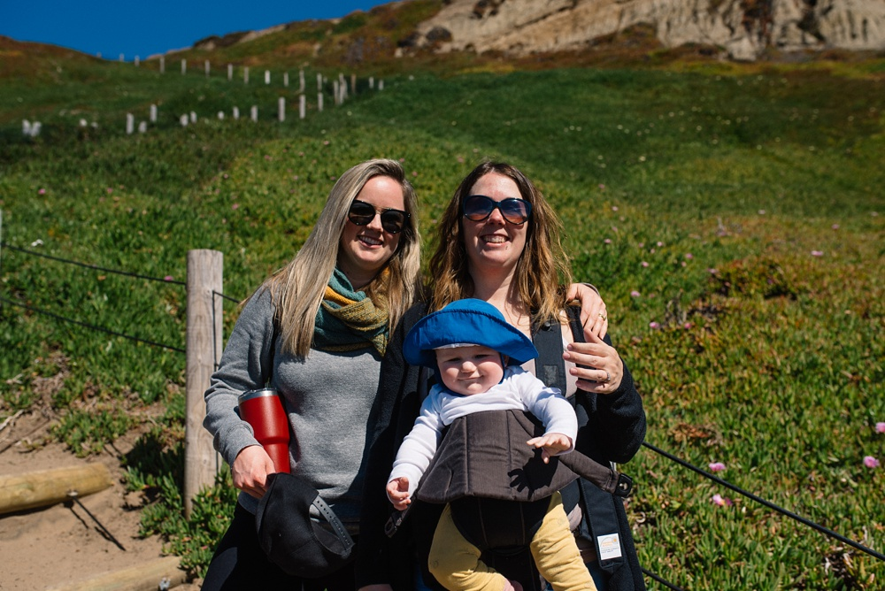 Hiking down the trail to the beach at Fort Funston outside of San Francisco, California. Travel portrait photography by Max Salzburg of Sonja K Photography.