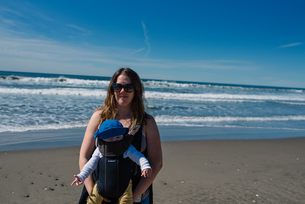 Sonja and Theo on the beach at Fort Funston outside of San Francisco, California. Travel portrait photography by Max Salzburg of Sonja K Photography.