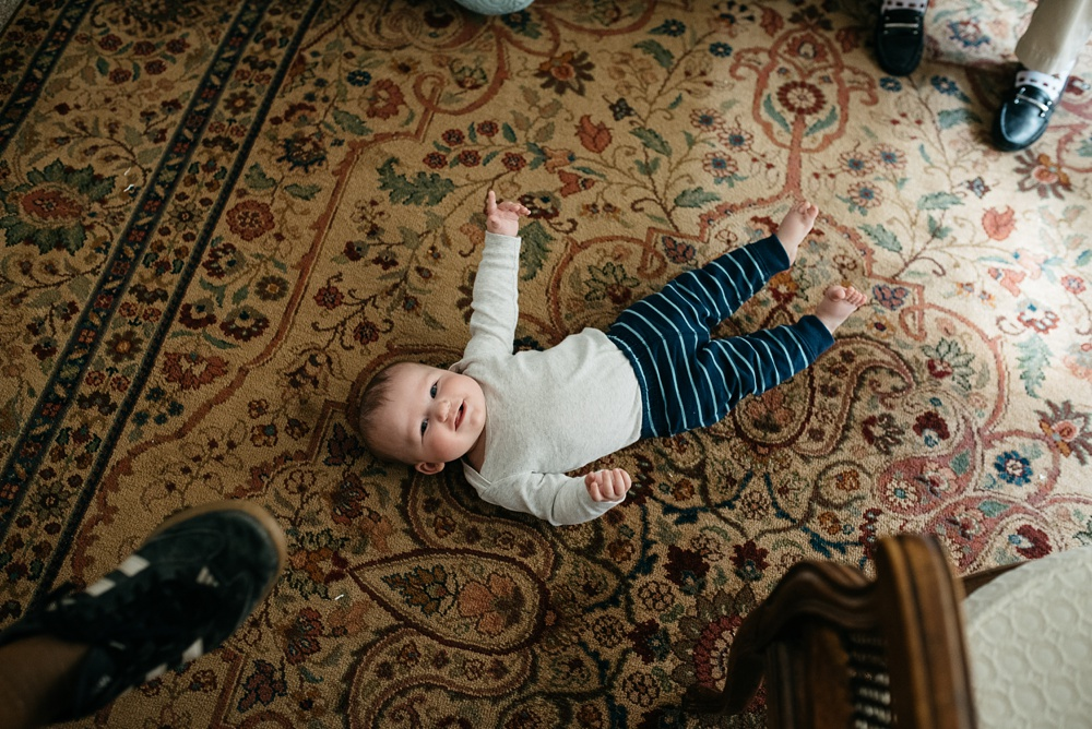 Theo hangs out on the rug at Sonja's Grandmothers' apartment in Portola Valley, California. Travel family portrait photography by Sonja Salzburg of Sonja K Photography.