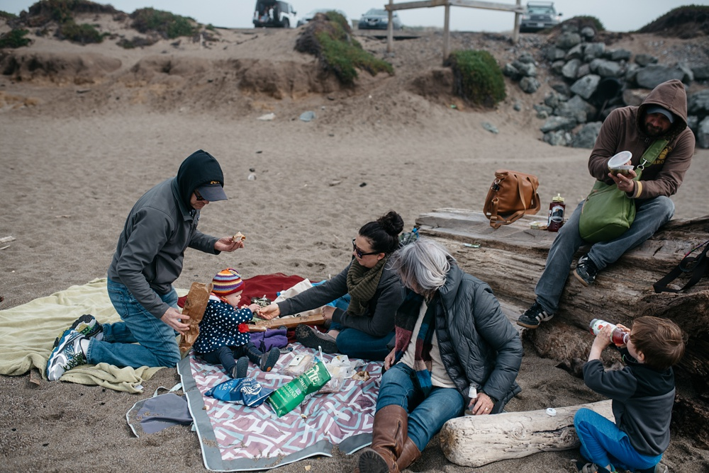 A family picnic at South Beach at Point Reyes National Seashore in California. Travel family portrait photography by Sonja Salzburg of Sonja K Photography.