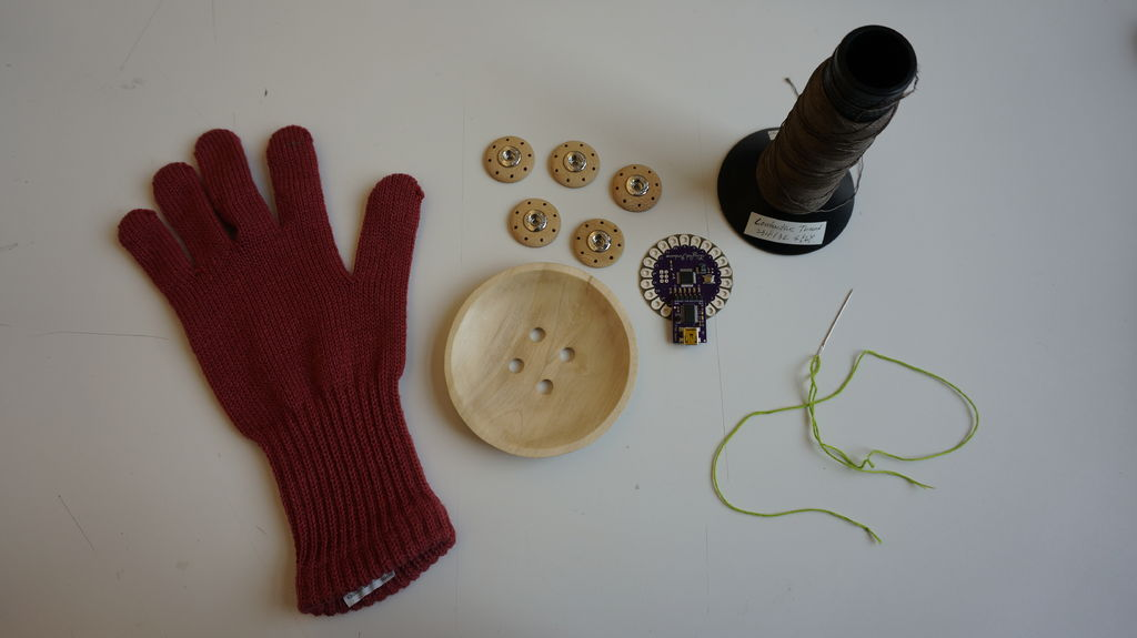 Step 1: Materials Necessary -  Glove, LilyPad Arduino, 1Pink LED, Conductive Thread, Colored Threads, Buttons
