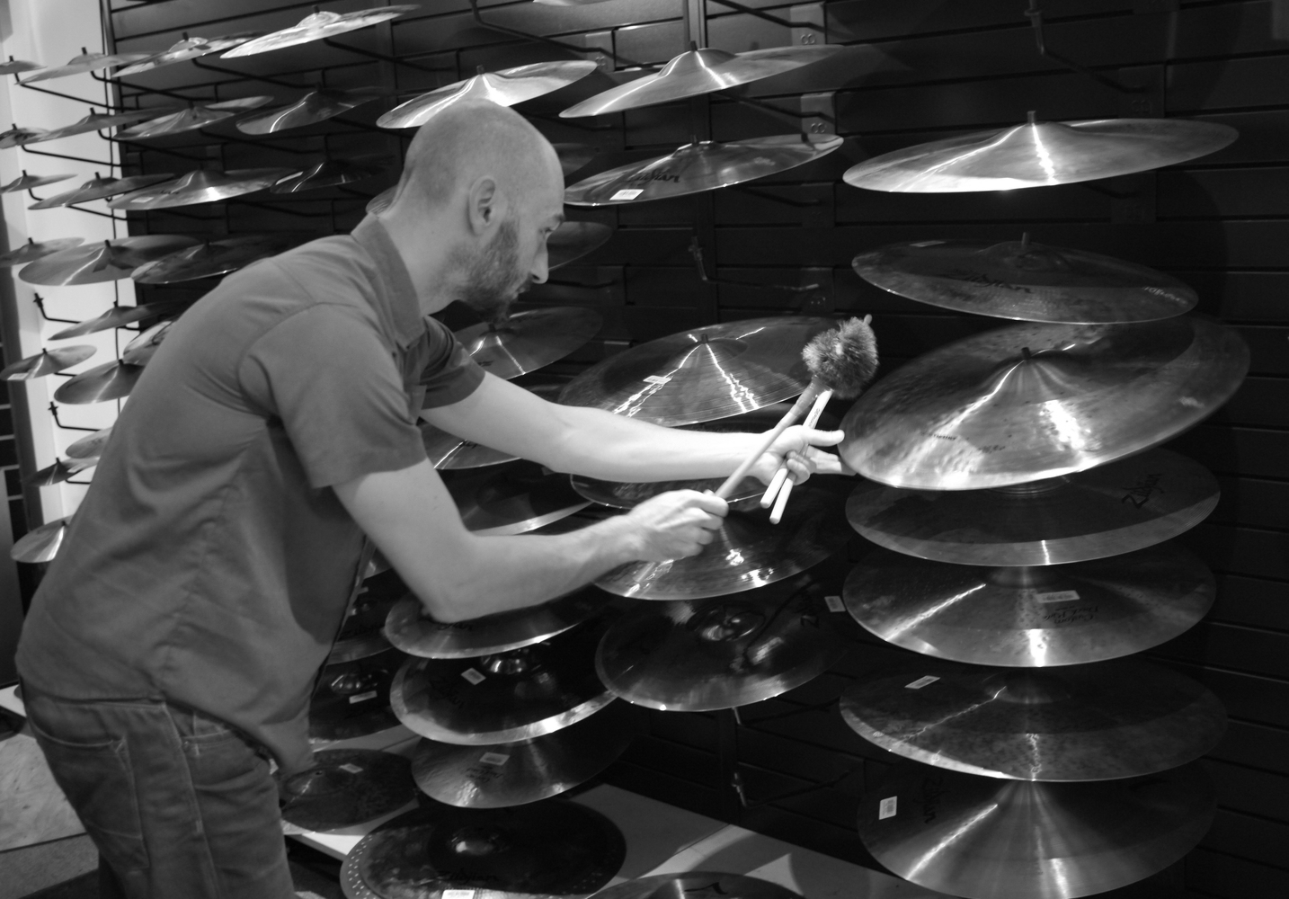 Testing and selecting cymbals at   Klangfarbe   music shop for the creation of CYMBAL ROLLS
