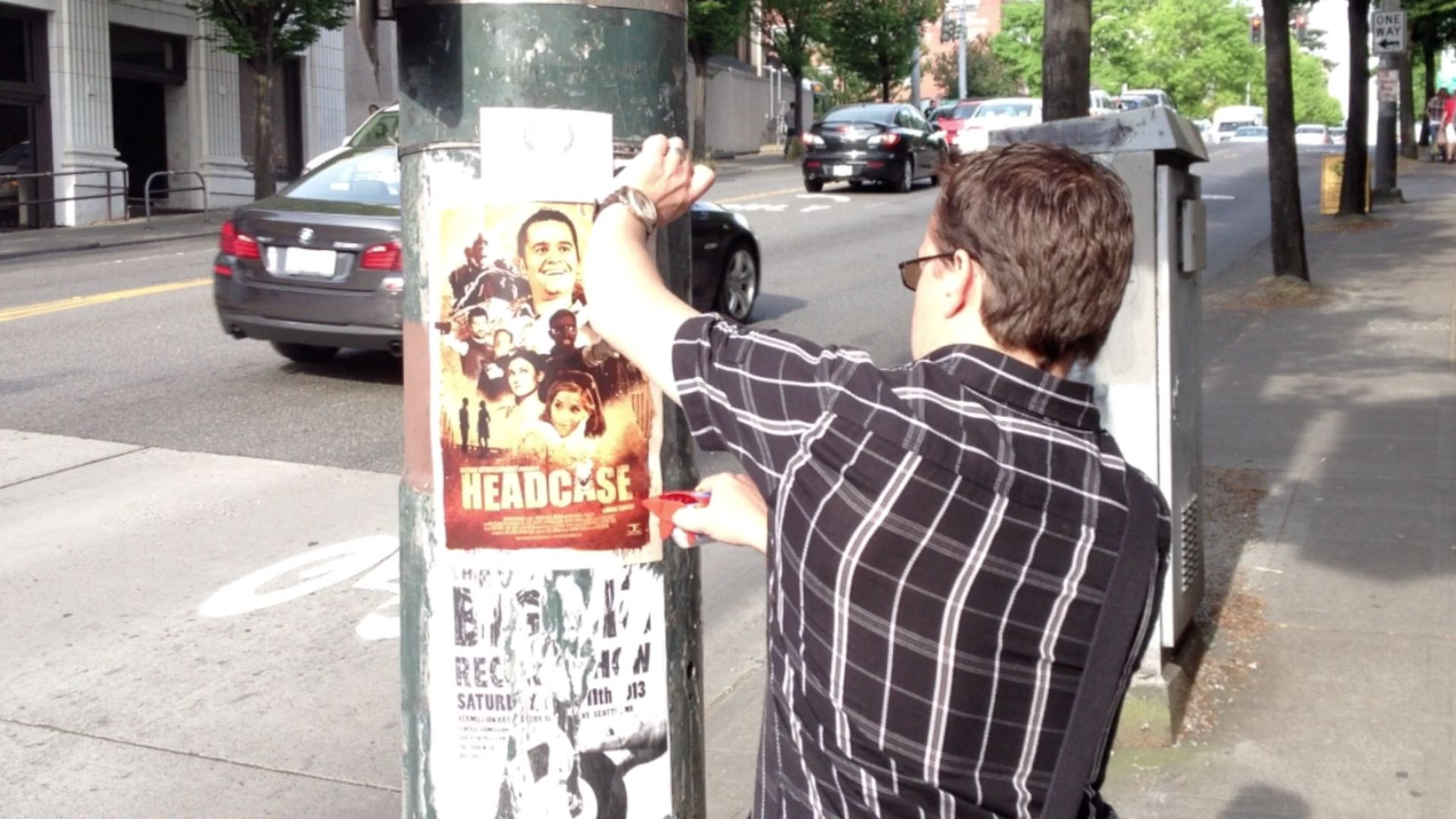 Producer, Alex Jordan plastering Seattle with posters